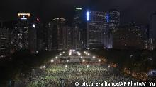 In this aerial view, participants gather for a vigil to remember the victims of the 1989 Tiananmen Square Massacre, despite permission for it being officially denied, at Victoria Park in Causeway Bay, Hong Kong, Thursday, June 4, 2020. China is tightening controls over dissidents while pro-democracy activists in Hong Kong and elsewhere try to mark the 31st anniversary of the crushing of the pro-democracy movement in Beijing's Tiananmen Square. (AP Photo/Vincent Yu) |
