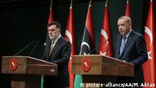 Turkish President Recep Tayyip Erdogan and Libyan Prime Minister Fayez al-Sarraj at a joint press conference at Presidential Complex in Ankara