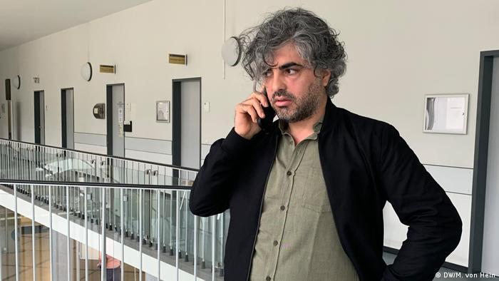 Film director Feras Fayyad talks on his phone