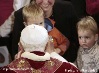 Pope Benedict XVI meeting with children during a mass