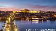 Prague, Czech Republic - March 16, 2017: Evening view of Prague Castle and Charles Bridge from the Old Town Bridge Tower | Verwendung weltweit