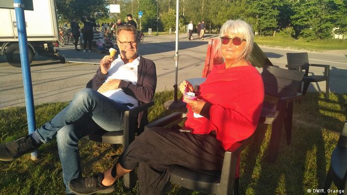 Karin and her husband eat ice cream near Ribersborg beach in Malmo, Sweden