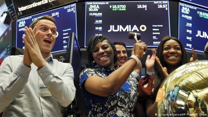 Jumia CEO Juliet Anammah (center) celebrates on the floor of the New York Stock Exchange.