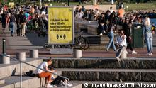 People enjoy the warm evening at Sundspromenaden in Malmo, Sweden, on May 26, 2020. The sign reads In Malmo everything is near. But now we need to keep a distance . MALM÷ SWEDEN x50090x *** People enjoy the warm evening at Sundspromenaden in Malmo, Sweden, on May 26, 2020 The sign reads In Malmo everything is near But now we need to keep a distance MALM÷ SWEDEN x50090x, PUBLICATIONxINxGERxSUIxAUTxONLY Copyright: xJohanxNilsson/TTx SWEDEN DAILY LIFE WEATHER CORONA
