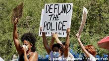 Protesters rally Wednesday, June 3, 2020, in Phoenix, demanding the Phoenix City Council defund the Phoenix Police Department. The protest is a result of the death of George Floyd, a black man who died after being restrained by Minneapolis police officers on May 25. (AP Photo/Matt York) |