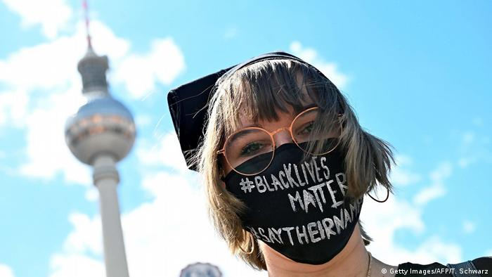 A protester with a Black Lives Matter face mask (Getty Images/AFP/T. Schwarz)