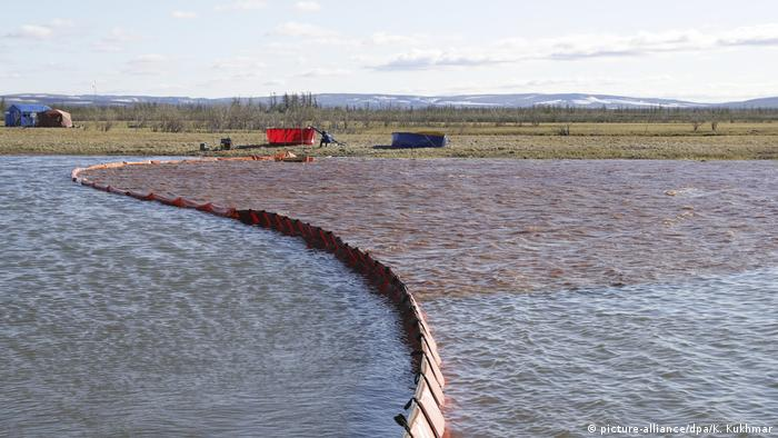 A containment boom holds back diesel fuel on the Ambarnaya River