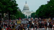 Protesters march near the US Capitol in Washington, DC, during a demonstration against racism and police brutality, on June 6, 2020. - Demonstrations are being held across the US following the death of George Floyd on May 25, 2020, while being arrested in Minneapolis, Minnesota. (Photo by ROBERTO SCHMIDT / AFP) (Photo by ROBERTO SCHMIDT/AFP via Getty Images)