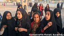 FILE PHOTO: Afghan refugee girls gather at the Bardsir settlement for Afghan refugees in Kerman province, Iran, October 22, 2016. Picture taken October 22, 2016. REUTERS/Gabriela Baczynska/File Photo