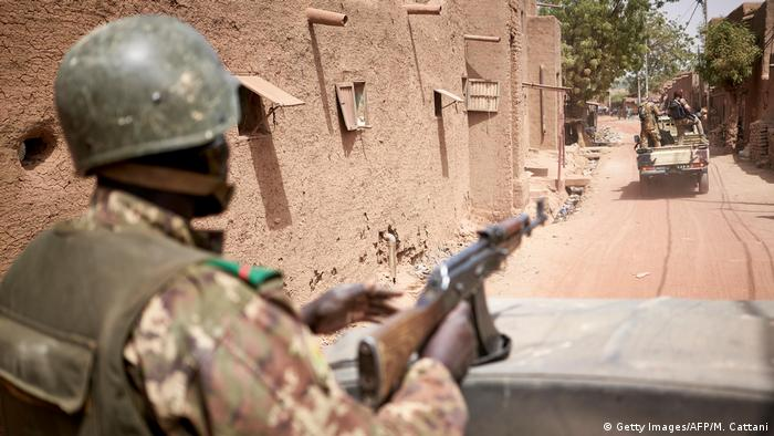 Troops of the Malian army patrol the ancient town of Djenne in central Mali