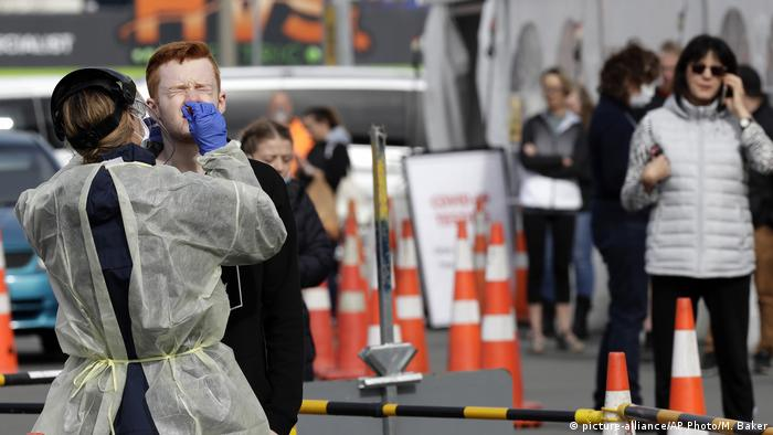 Medical staff test shoppers who volunteered at a pop-up community COVID-19 testing station at a supermarket carpark in Christchurch