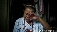 Unyakarn Booprasert, 59, who survived after she tried to take her own life in April outside Thailand's finance ministry building, during the coronavirus disease (COVID-19) outbreak, cries during an interview with Reuters, at her home in Samut Sakhon province, Thailand, May 29, 2020. Booprasert, who has since recovered, told Reuters she had tried to kill herself to speak for other people who suffered like me. REUTERS/Athit Perawongmetha TPX IMAGES OF THE DAY SEARCH THAILAND SUICIDE FOR THIS STORY. SEARCH WIDER IMAGE FOR ALL STORIES.