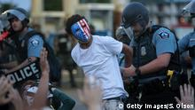 MINNEAPOLIS, MINNESOTA - MAY 31: A demonstrator is arressted during a protest against police brutality and the death of George Floyd, on May 31, 2020 in Minneapolis, Minnesota. Protests continue to be held in cities throughout the country over the death of George Floyd, a black man who died while in police custody in Minneapolis on May 25. (Photo by Scott Olson/Getty Images)