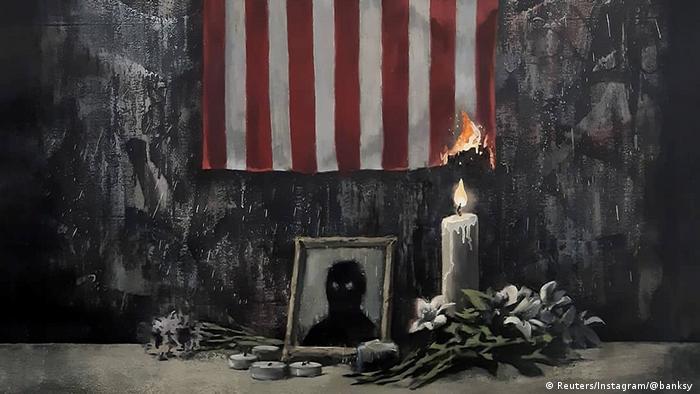 Banksy artwork: a US flag set on fire by a vigil candle (Reuters/Instagram/@banksy )