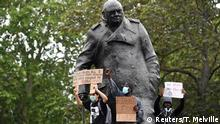 People climb on the Winston Churchill statue in Westminster during a Black Lives Matter protest following the death of George Floyd who died in police custody in Minneapolis, London, Britain, June 3, 2020. REUTERS/Toby Melville