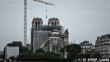 A picture shows the Notre-Dame Cathedral during the first day of the dismantling operations of the scaffolding in Paris on June 8, 2020 that was damaged in the April 15, 2019 blaze. (Photo by Philippe LOPEZ / AFP)