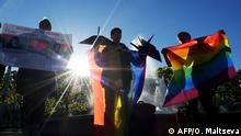 Some ten Gay right activists attend a rally as they mark World Day Against Homophobia and Transophobia in Saint Petersburg on May 17, 2019. - Four of the LGBT activists arrested in Russia's second largest city. (Photo by Olga MALTSEVA / AFP)