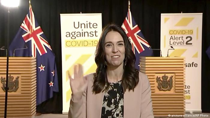 New Zealand's Prime Minister Jacinda Ardern smiles and waves at the camera