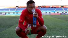 This photo taken on September 24, 2017 shows a player of Zibo Sunday using an oxygen tank during their 2017 Chinese Football Association Amateur League football match against Lhasa Chengtou at the People's Cultural and Sports Center, located at a height of 3,658 metres (12,000 feet) above sea level, in Lhasa in China's western Tibet Autonomous Region. - There will be mid-game oxygen breaks but no team will fancy a trip to sky-high Lhasa Chengtou next season after they made history in becoming the first Tibetan side to reach China's professional league. (Photo by STR / AFP) / China OUT / TO GO WITH AFP STORY FBL-ASIA-CHN-TIBET-MINORITIES,FOCUS BY PETER STEBBINGS (Photo by STR/AFP via Getty Images)