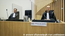 Public prosecutor Ward Ferdinandusse, right, waits for the trial to resume at the high security court building at Schiphol Airport, near Amsterdam, Monday, June 8, 2020, for three Russians and a Ukrainian charged with crimes including murder for their alleged roles in the shooting down of Malaysia Airlines Flight MH17 over eastern Ukraine nearly six years ago. (AP Photo/Robin van Lonkhuijsen, POOL) |