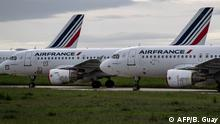 (FILES) This file photo taken on April 30, 2020 shows Air France planes parked on the tarmac at Paris Charles de Gaulle Airport in Roissy, on the 45th day of the novel coronavirus COVID-19. - The French government on June 9, 2020 pledged 15 billion euros (USD 16.9 billion) for the country's aviation industry, where thousands of jobs are on the line as the coronavirus crisis hammers the travel industry. (Photo by BERTRAND GUAY / AFP)