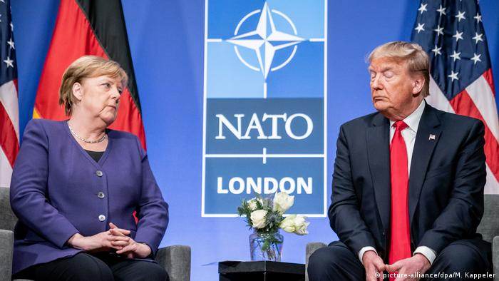 Merkel and Trump at the NATO meeting (picture-alliance/dpa/M. Kappeler)