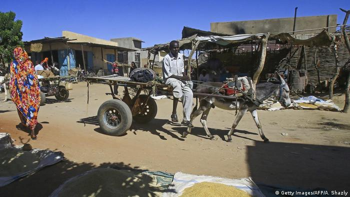 A picture taken on November 5, 2019 shows diplaced Sudanese at the Abu Shouk camp for internally displaced persons, nearly 20 kms north of El-Fasher, the capital of the North Darfur state