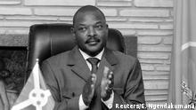 FILE PHOTO: Burundi President Pierre Nkurunziza claps after signing the new constitution at the Presidential Palace in Gitega Province, Burundi June 7, 2018. REUTERS/Evrard Ngendakumana/File Photo