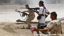 A file picture of armed men opening fire in the Libyan capital, Tripoli
