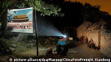 Bildergalerie Outdoor-Kinos | China Zaozhuang 2011 (picture-alliance/dpa/Maxppp/ChinaFotoPress/H. Xiaodong)