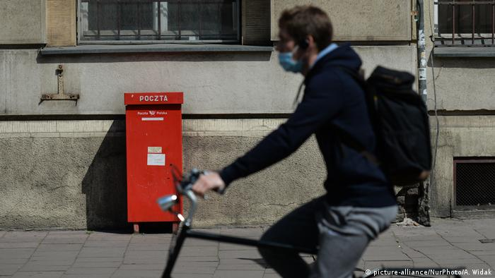 A new hybrid system of postal and conventional voting is in place on Sunday in a bid to stem infections