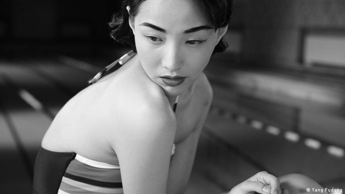 Chinese woman in a bathing suit; black-and-white photo by Yang Fudong