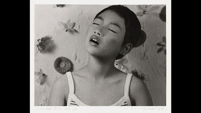 Girl with closed eyes; black-and-white photograph by Wang Ningde
