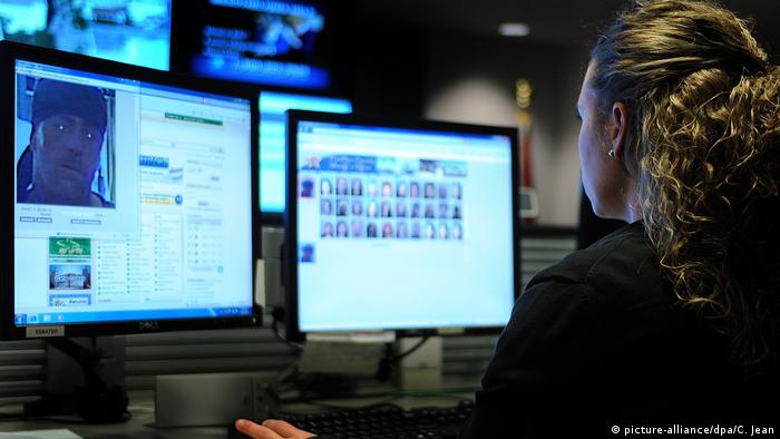 A US police officer uses a facial recognition software tool to identify suspects in Palm Beach, Florida