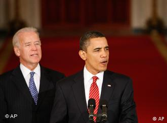 Barack Obama and Joe Biden after the passage of the health care bill