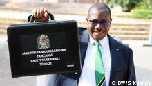 Photo 2 Waziri: Minister of finance in Tanzania Dr. Philip Mpango holding a bag which contains governemt budget for 2020/2021 and was presented on thursday 11.06.2020 in parliament Dodoma Tanzania. DW/Said Khamis