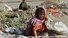 Pakistani girl Taleema collects food from a garbage dump in Islamabad on June 12, 2010, on the World Day against Child Labour. The UN Children's Fund called for urgent action on child labour, saying that with more than 150 million underage workers worldwide the problem threatens the UN's millennium development goals. AFP PHOTO/Farooq NAEEM (Photo by Farooq NAEEM / AFP) (Photo by FAROOQ NAEEM/AFP via Getty Images)