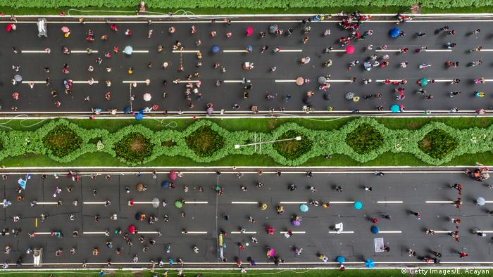 Aerial shot of people social distancing during a protest on a highway