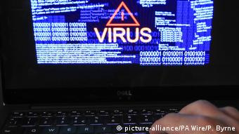 photo of a laptop screen showing a computer virus warning