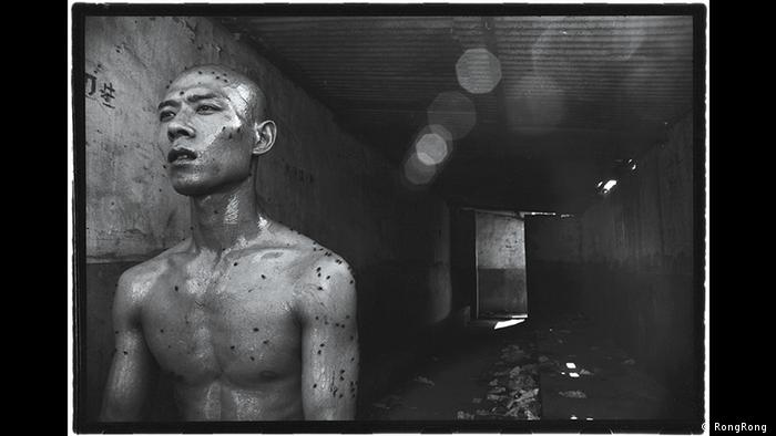 Chinese man with unclothed torso, photo by RongRong