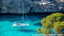 PALMA DE MALLORCA, SPAIN - MAY 23 2020 : Sailing boat at Caló del Moro at - Mallorca during Corona Lock down on May 23, 2020 in Palma de Mallorca, . | Verwendung weltweit
