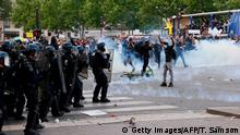French riot police forces throw tear at protesters during a rally as part of the 'Black Lives Matter' worldwide protests against racism and police brutality, on Place de la Republique in Paris on June 13, 2020. - A wave of global protests in the wake of US George Floyd's fatal arrest magnified attention on the 2016 death in French police custody of Adama Traore, a 24-year-old black man, and renewed controversy over claims of racism and brutality within the force. (Photo by Thomas SAMSON / AFP) (Photo by THOMAS SAMSON/AFP via Getty Images)