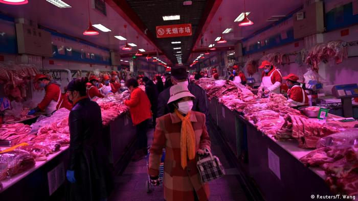 A woman shopping in the Xinfadi market in Beijing.