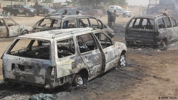 Burnt out cars line the road after an attack