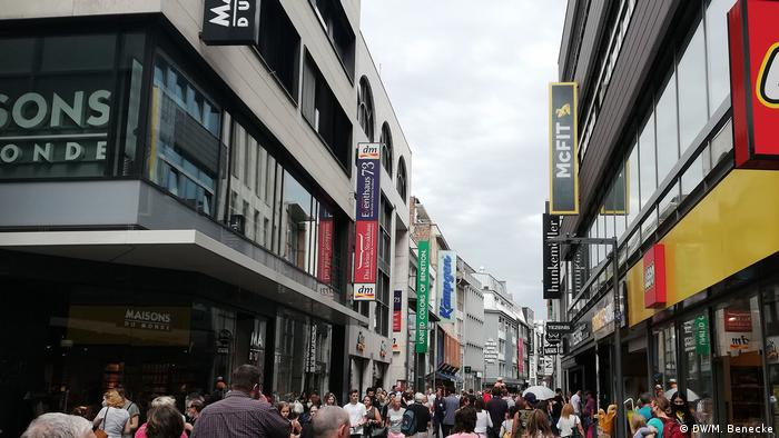 Cologne's central shopping street, filled with pedestrians