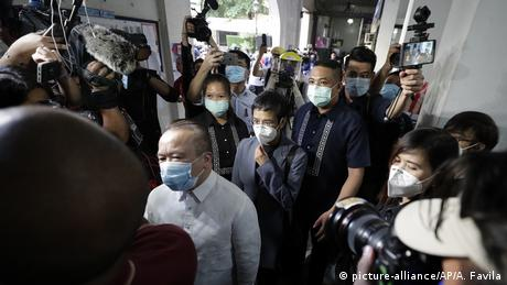 Rappler CEO and Executive Editor Maria Ressa, center, is escorted as she arrives to attend a court hearing for a cyber libel case at Manila Regional Trial Court, Philippines