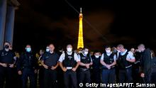 French police officers protest at Trocadero square in front of the Eiffel Tower in Paris on June 14, 2020, in reaction to the French Interior Minister's latests announcements following demonstrations against police violence. (Photo by Thomas SAMSON / AFP) (Photo by THOMAS SAMSON/AFP via Getty Images)