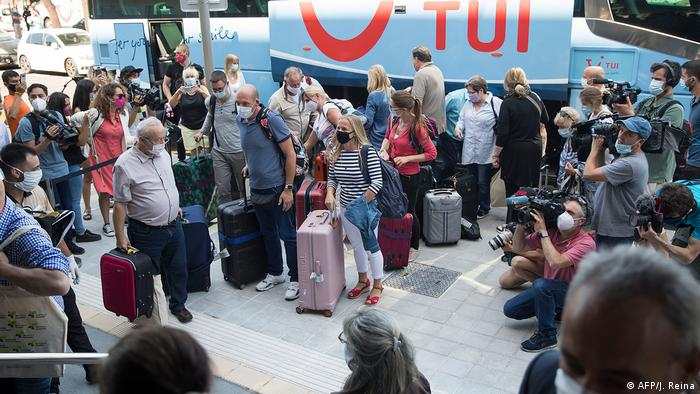 Group of reporters around the tourists in front of the Hotel Riu Concordia, Mallorca, Spain