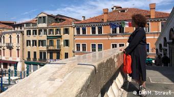 Jane Da Mosto, executive director of We Are Here Venice, stands on the Rialto bridge