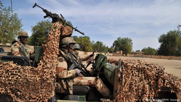 Soldiers sitting in a camouflaged vehicle in Mali